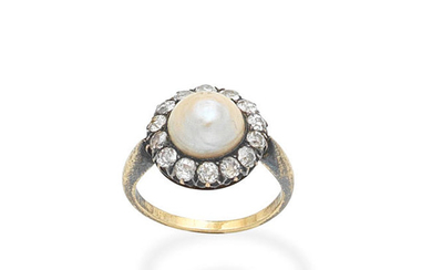 A natural half pearl and diamond cluster ring