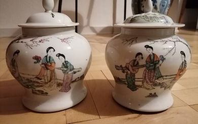 A pair of Chinese enamelled porcelain lidded vases painted with scenary and poetry. Sealmark of Tongzhi. H. 20 cm. (2)