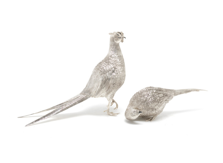 A pair of life-size silver pheasants