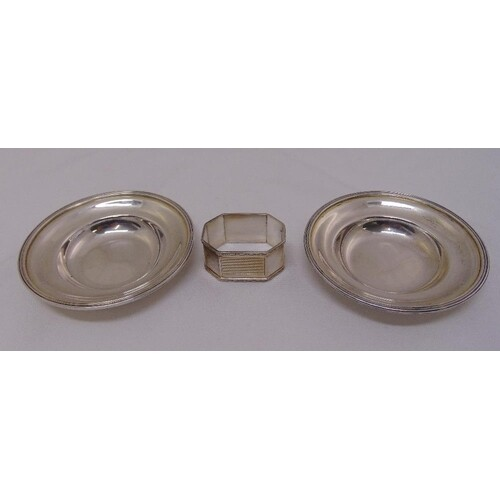 A pair of silver coasters and an engine turned napkin ring, ...