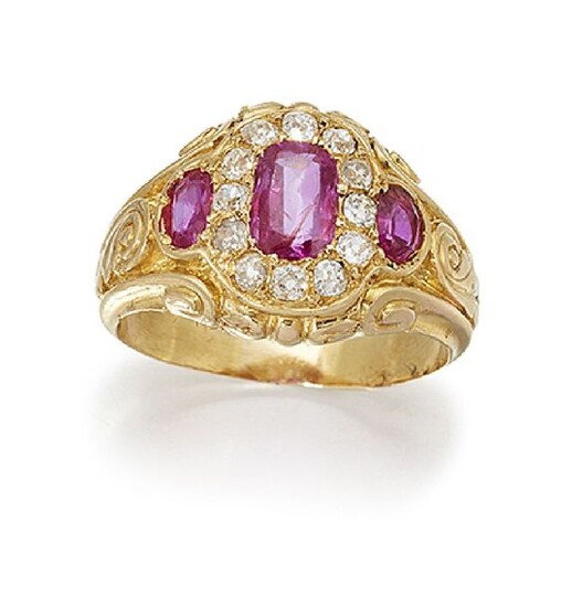 A ruby and diamond cluster ring, the central...