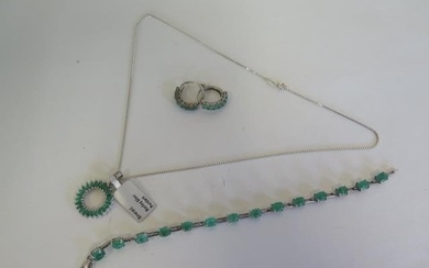 A silver pendant set with emeralds, a pair of silver emerald...