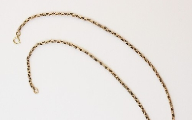 A yellow metal spiga link chain, with spring ring fastening,...
