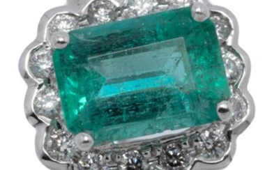 AN 18CT WHITE GOLD EMERALD AND DIAMOND RING; centring an emerald cut emerald of approx. 1.15ct to surround and shoulders set with a...