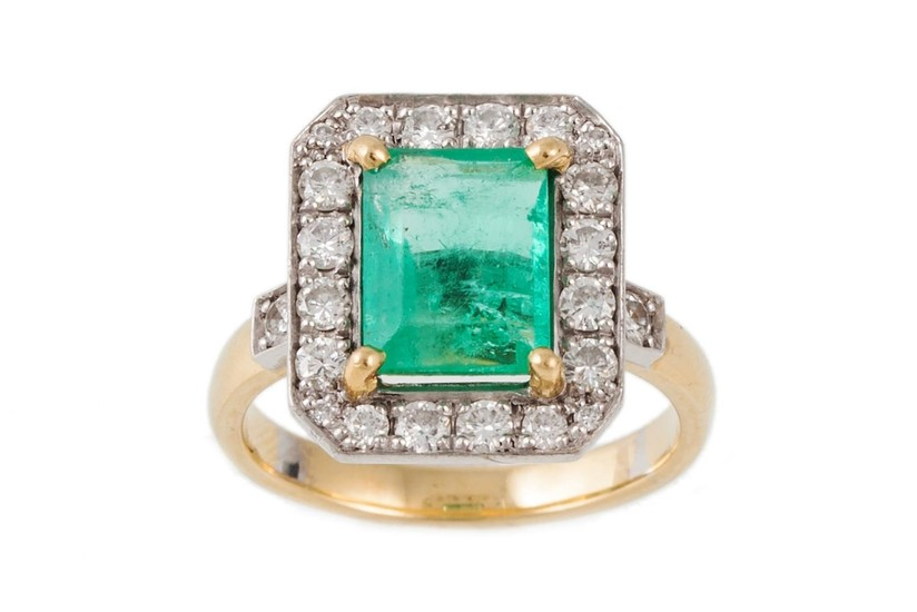 AN EMERALD AND DIAMOND CLUSTER RING, the central emerald sur...
