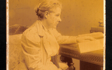AUTOGRAPH. A large albumen-print photograph of Annie Besant, signed below the image in ink, overall