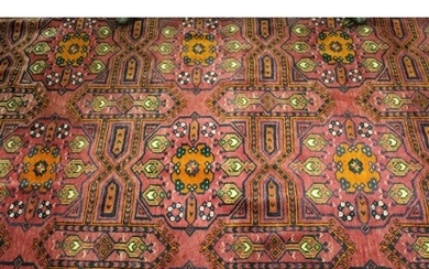 Afghan carpet with three rows of six gols on a wine ground w...