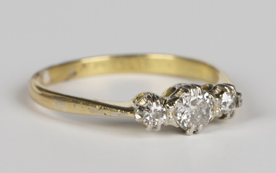 An 18ct platinum and diamond ring, claw set with the principal circular cut diamond between two smal