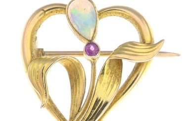 An Art Nouveau 15ct gold opal and ruby brooch.Stamped