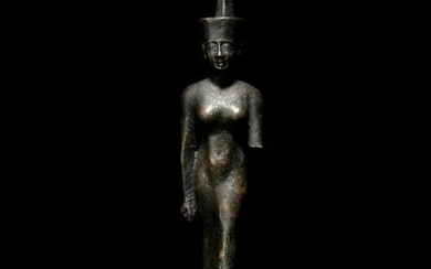 An Egyptian Bronze Striding Neith Height 5 7/8 inches.