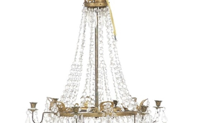 An Empire style six-light crystal chandelier with bronze frame and red glass bottom. Two inside...