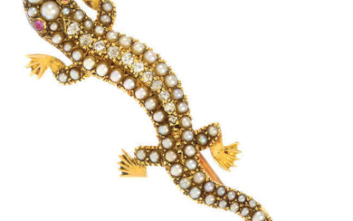 An early 20th century 15ct gold split pearl lizard brooch, with old-cut diamond line and ruby eyes.