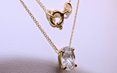 Exceptional and rare Natural white sapphire in oval diamond cut of 1.60 carat on 18 kt yellow gold necklace and pendant. Unique pendant, hand carved by a designer, 40 cm long chain in forçat mesh directly welded to the cat's hooks. Weight 1.51g.
