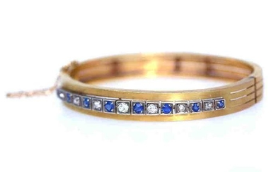 Fine gold bracelet with Diamonds and Sapphires.