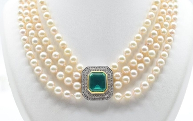 Necklace of 4 rows of pearls with charm and clasp in 18 ct yellow and white gold set with 77 brilliants +/- 2.20 ct and 1 emerald (42 cm)
