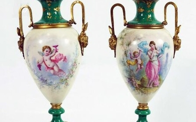 PAIR OF PORCELAIN COVERED URNS
