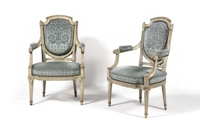 Pair of moulded and carved beechwood armchairs with curved and indented backs at the top, column uprights with fluted and beaded friezes, the belt with a recessed and channelled waist resting on tapered legs with rough fluting. Louis XVI period. H: 97...
