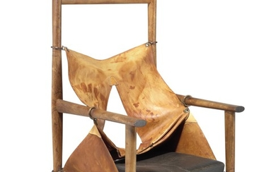 Peter Karpf: A unique high back armchair of Brazilian rosewood. Seat and back with patinated grain leather, loose seat cushion with brown leather.