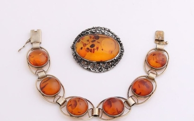 Silver brooch and bracelet with amber. Bracelet
