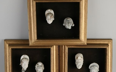 Six antique framed Chinese terracotta heads. 18th