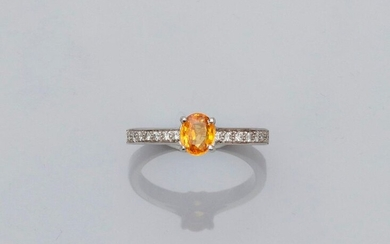Solitaire ring in white gold, 750 MM, set with an oval yellow sapphire weighing 0.80 carat and set with two lines of brilliants, size: 53, weight: 3.75gr. gross.