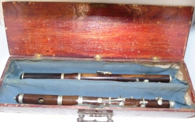 Two cased vintage marching flutes