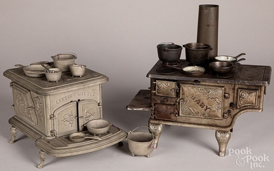 Two cast iron toy stoves