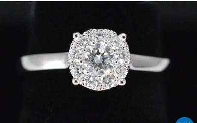 White gold ring with 0.50 carat diamond.