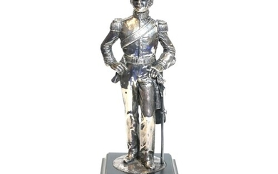 A 20th CENTURY SILVER STATUE OF A BRITISH CAVALRY SOLDIER, i...