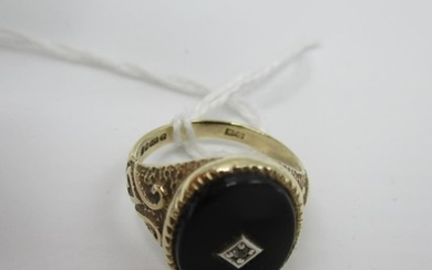A 9ct gold signet ring set with a black tablet and diamond, ...
