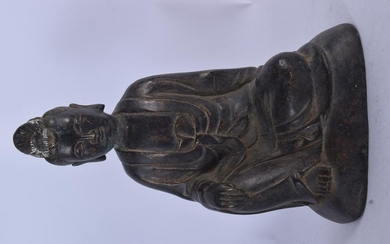 A CHINESE BRONZE STATUE OF GUANYIN. 23.5 cm high.