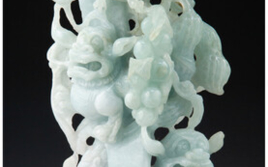 A Chinese Carved Celadon Jade Shi-Shi Figural Group