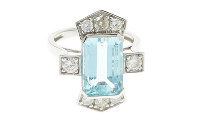 A DECO STYLE PLATINUM AQUAMARINE AND DIAMOND RING; centring an approx. 6.80ct emerald cut aquamarine set at each end and on the upsw...