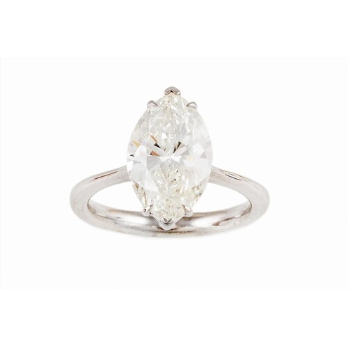 A DIAMOND SOLITAIRE RING, the marquise cut diamond mounted i...
