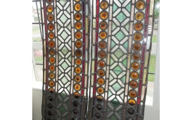 A PAIR OF VICTORIAN STAINED GLASS PANELS. (35cm x 107cm)