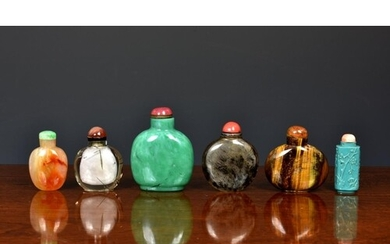 A collection of Chinese rock crystal and stone snuff bottles...