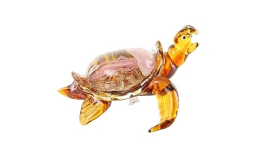 A glass figure of a tortoise - Very colorful