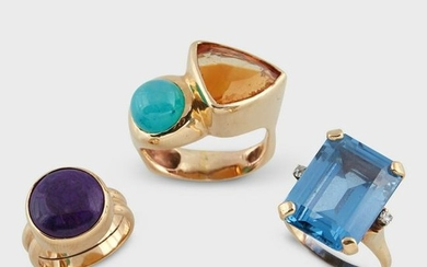 A group of three gem-set fourteen karat gold rings