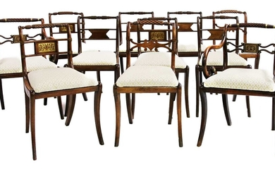 A harlequin set of eleven George III mahogany dining chairs