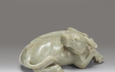 A large Chinese celadon-grey jade buffalo carving Carved as...