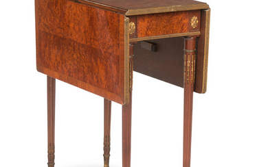 A late 19th century French birdseye maple and crossbanded drop-leaf table