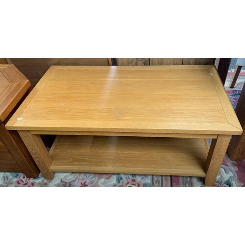 A modern oak coffee table with under tier, 110cm wide x 60cm...