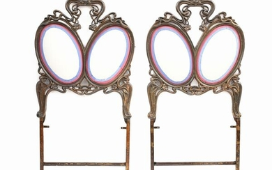 A pair of Art Nouveau cast iron headboards