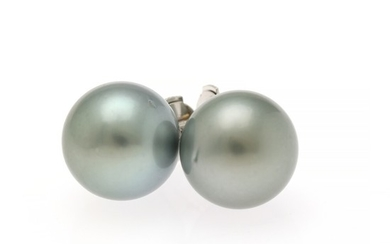 A pair of Tahiti pearl ear studs each set with a cultured Tahiti pearl, mounted in 14k white gold. Diam. app. 12.7 mm. (2)