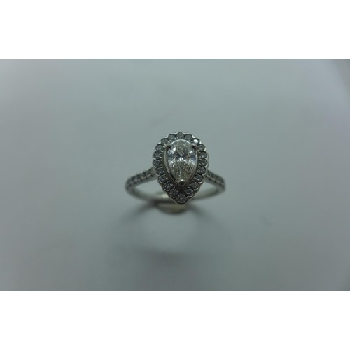 A platinum 950 pear shaped diamond cluster ring centre stone...