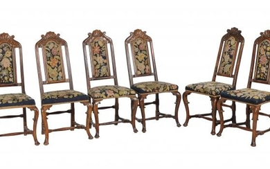**LOT WITHDRAWN**A set of six carved beech wood and upholstered dining chairs