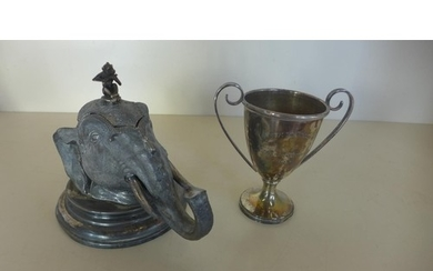 A silver plated desk inkwell in a the form of an elephants h...