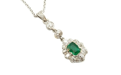 AN EMERALD AND DIAMOND PENDANT NECKLACE The claw-set