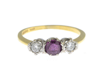 An 18ct gold diamond and ruby three-stone ring.