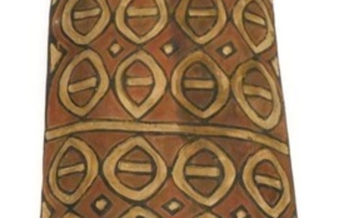 An African carved tribal shield, decorated with ovals, in cr...
